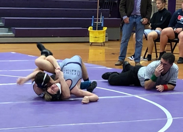 Senior Captain Preston Turner has a tight cradle to pin his opponent.