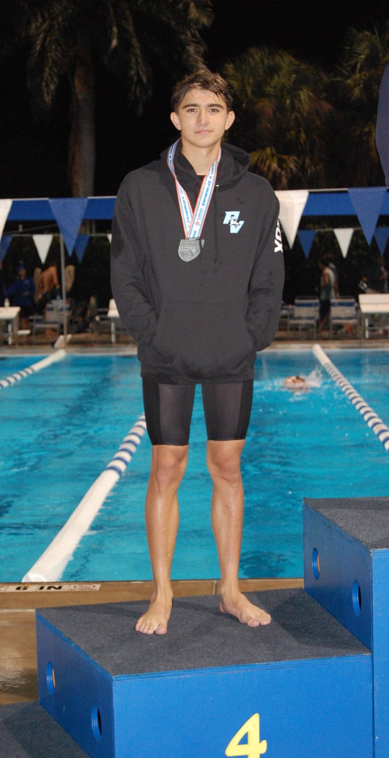 Sharks senior swimmer Nicholas Cox finished in fourth place in the 100 backstroke and eighth place in the 200 individual medley, breaking school records in both races.