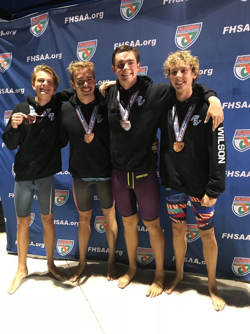 The boys 200 free relay team of Cleburne Wilson, Igor Kazhuro, Andrew Relihan and Max Milicevic finished in third place with a new school record.