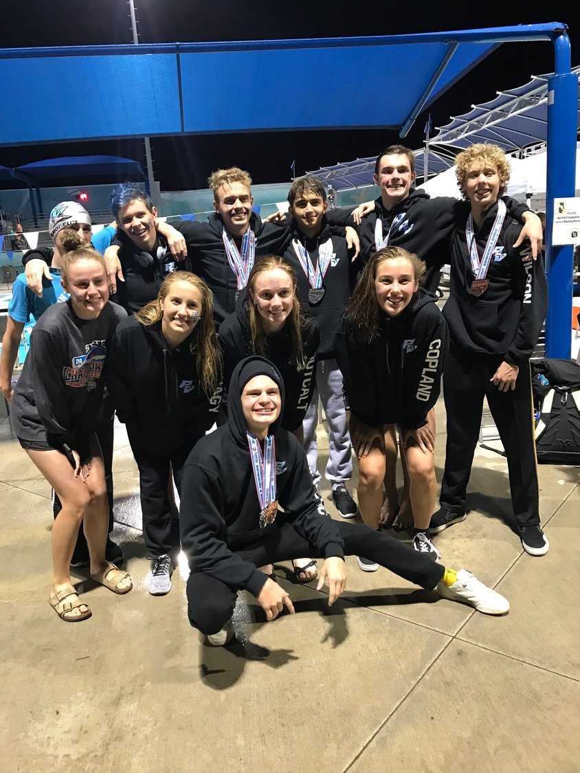 The Ponte Vedra Swim & Dive team gathers at the 2A Florida State Championships in Stuart, Florida, where they broke seven school records.