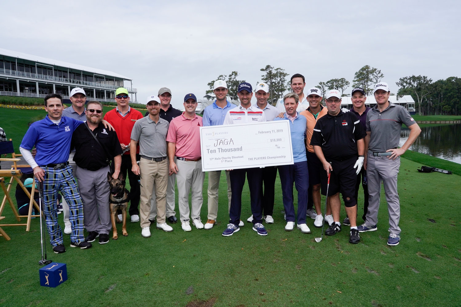 THE PLAYERS 2018 champion Webb Simpson gathers with participants of THE PLAYERS Charity Challenge on Monday at TPC Sawgrass. Simpson helped Davis Roche win the event and claim the $10,000 first-place prize for the JAGA Scholarship Trust.