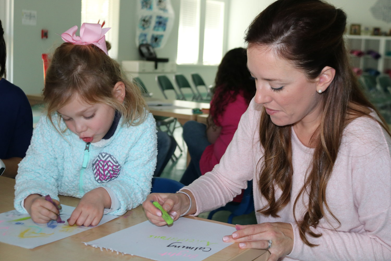 A parent and her child participate in a workshop on the Reggio Emilia Approach at Collage Day School in Ponte Vedra Beach on Feb. 14.