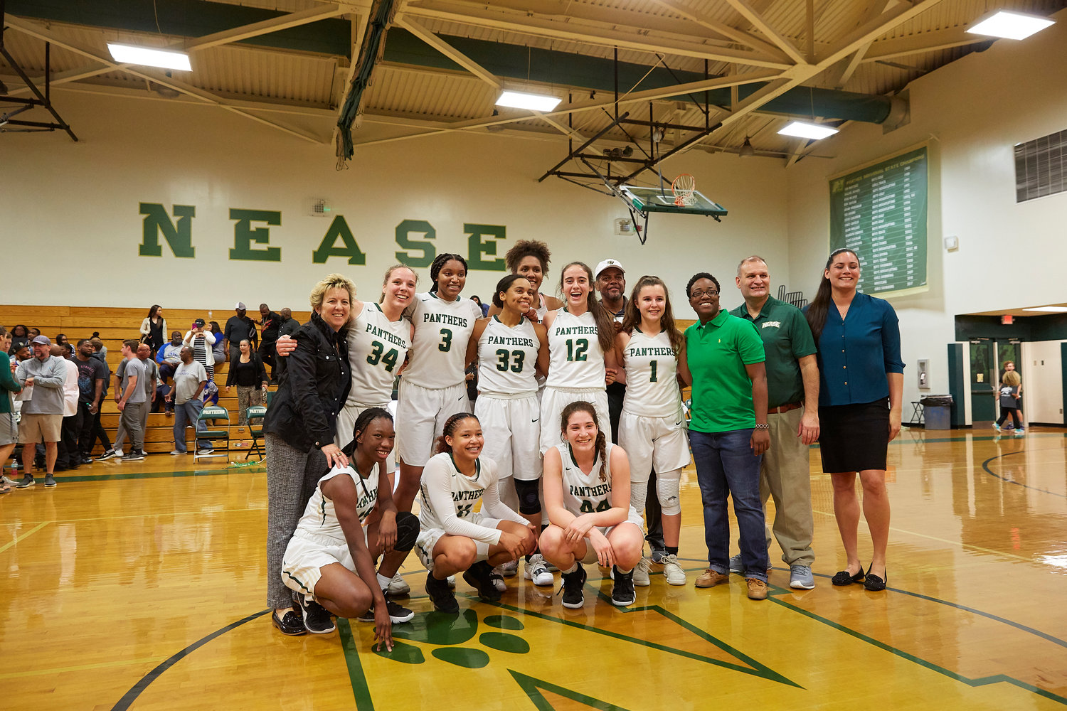 The Nease girls basketball team gathers after beating Booker T. Washington in the regional finals on Feb. 22 at home. The Lady Panthers will play Fort Myers in the state semifinals on March 1 at noon.