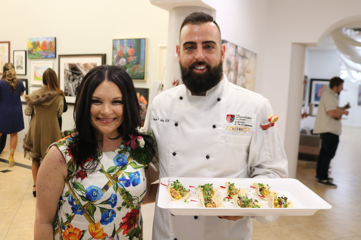 Donna Guzzo, executive director of the Cultural Center at Ponte Vedra Beach, and Vincent Pollaci of Weenie Panini gather at Art Tapas on March 1 at the Center.
