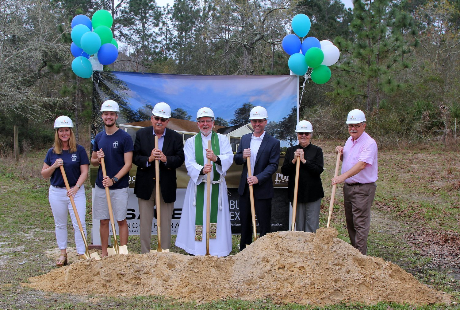 LeeAnn Anderson, Ryan Turner, Wayne Novak, Father Michael Ellis, Josh Tonge, Shirley Patterson and Ed d'Avi break ground on St. Francis in-the-Field Episcopal Church's new Founders Youth Building on March 3.