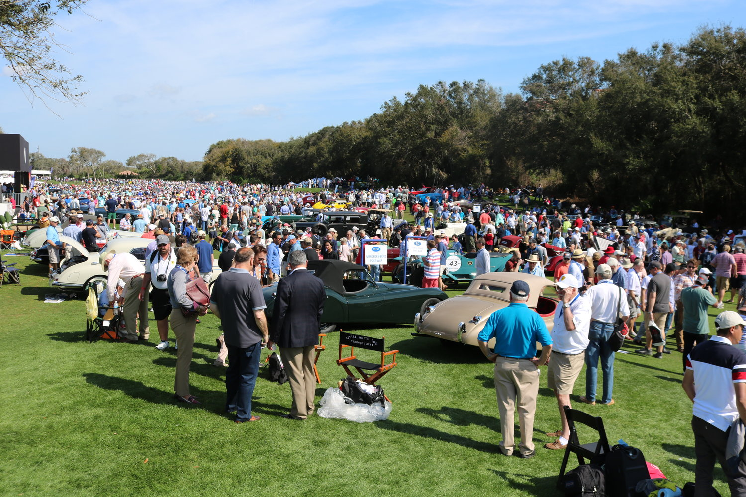 Thousands of car enthusiasts walk the grounds of the Golf Club of Amelia Island for the Concours.