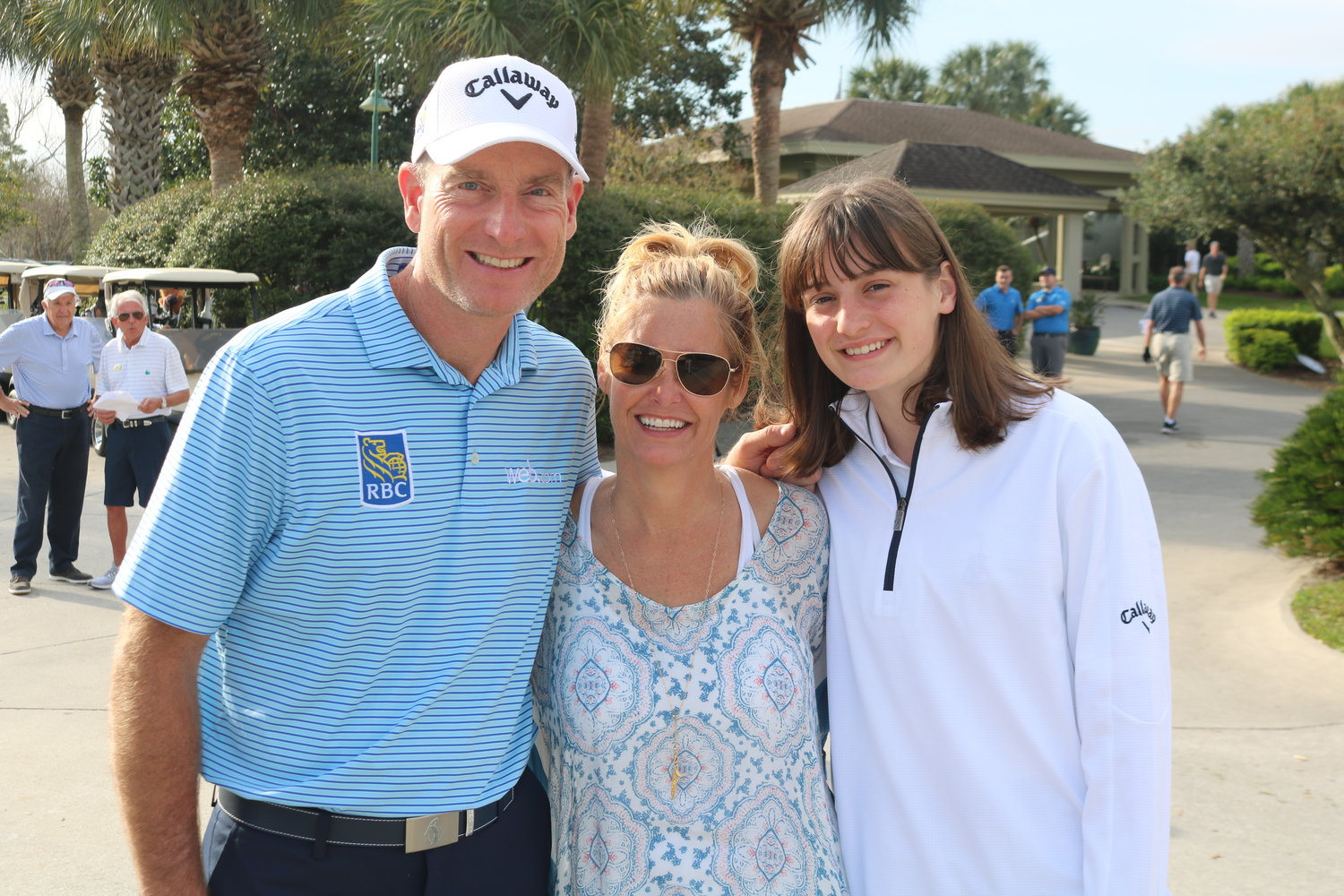 Jim, Tabitha and Caleigh Furyk gather at the Furyk Foundation golf tournament at Sawgrass Country Club on Monday, March 11.