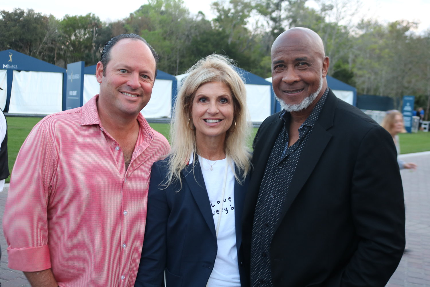 Lee and Tammy Kaplan with Lynn Swann at the concert
