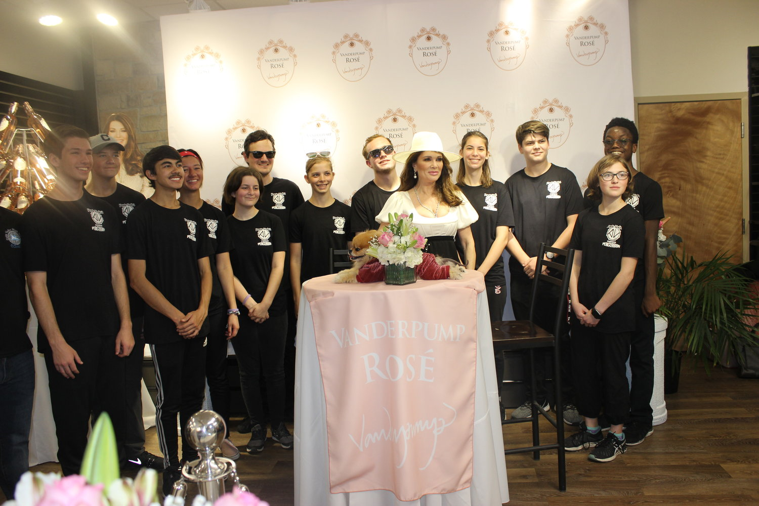 Television star Lisa Vanderpump gathers with the Ponte Vedra High School band on March 9 at Winn-Dixie in Ponte Vedra Beach, where she met with fans and introduced her Vanderpump Rosé.