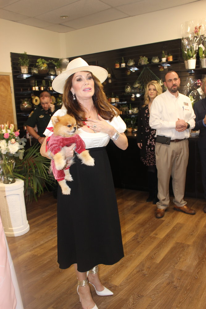 Vanderpump addresses the crowd at Winn-Dixie with her dog, Puffy.