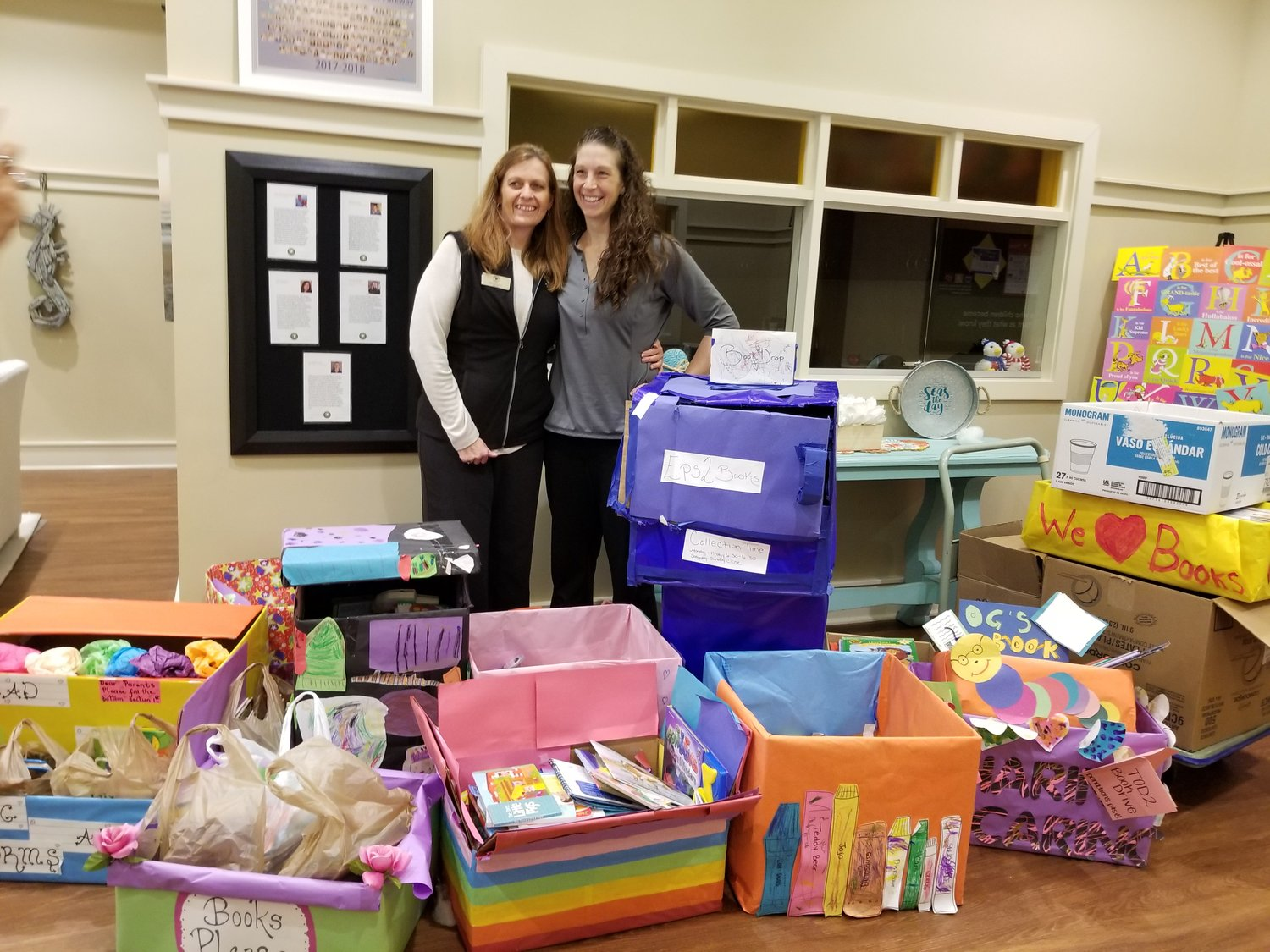 Kim Shannon and Kayleigh Toblin of Primrose School in Nocatee gather with some of the books that were collected in a February book drive. Three local Primrose Schools held drives and collected 2,000 books.