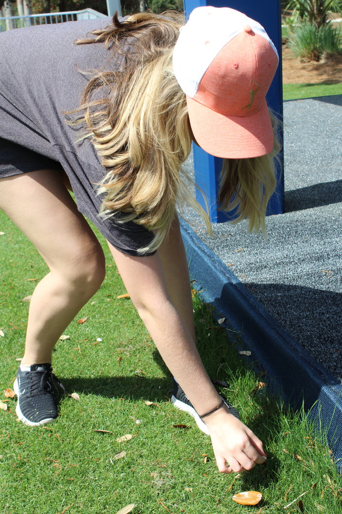 Ponte Vedra High School students help pick up trash at TPC Sawgrass before the start of THE PLAYERS.