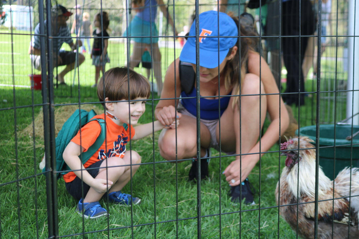 Attendees of the grand opening enjoy playing in the petting zoo.