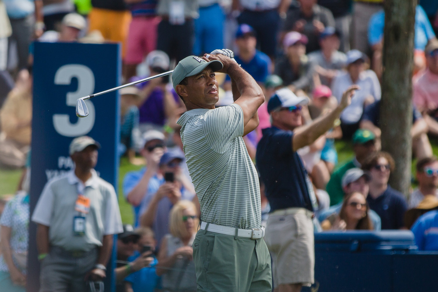 Tiger Woods hits a shot at THE PLAYERS. He's 2-under par, and five back of the lead, after the first round.