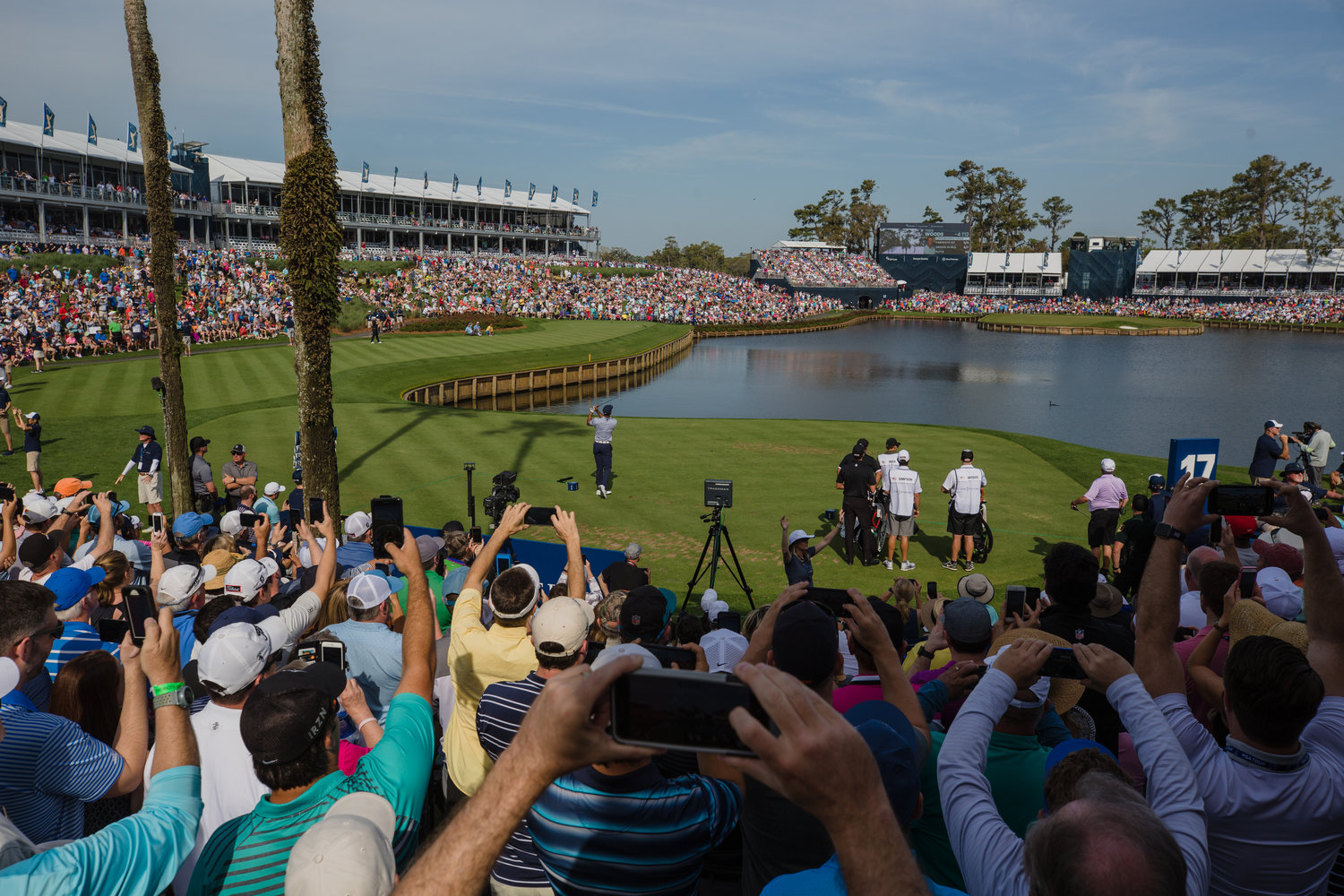 Tiger Woods attempts a shot at 17 on Friday of THE PLAYERS, where he ultimately carded a quadruple-bogey 7 on the 146-yard hole.