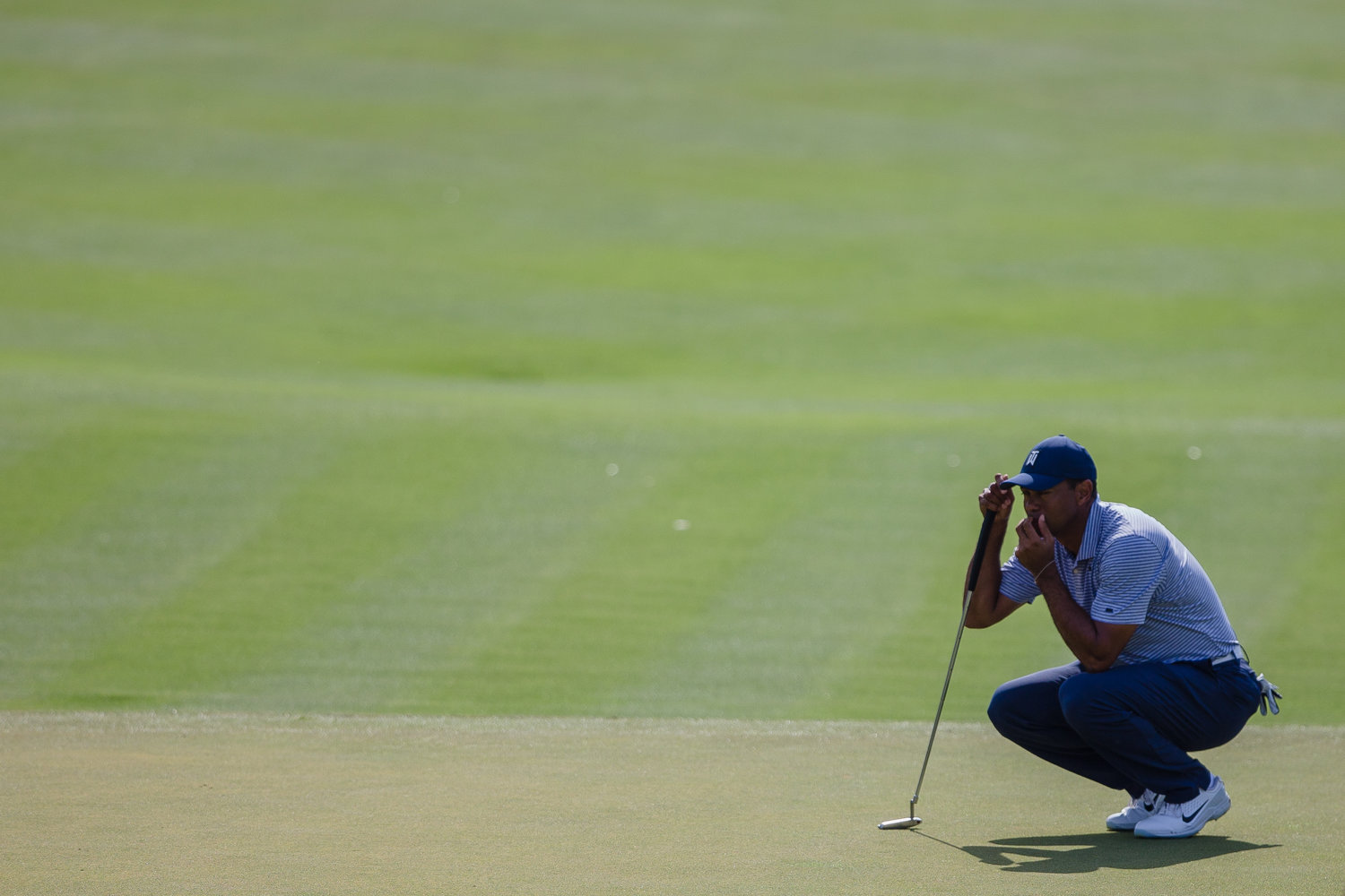 Tiger Woods eyes up a shot Friday at THE PLAYERS.