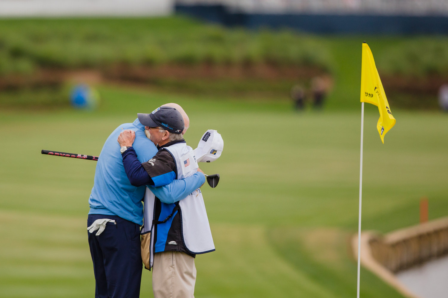 "Jim Furyk embraces his caddie, Mike ""Fluff"" Cowan, after his final round of THE PLAYERS on Sunday. Furyk finished runner-up to Rory McIlroy."