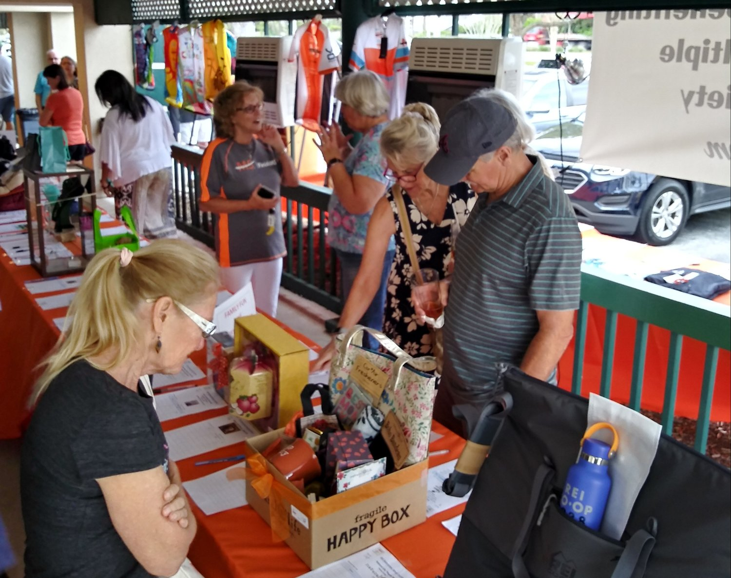 Area residents peruse the recent MS silent auction at Bogey Grille, which raised more than $20,000 for North Floridians impacted by multiple sclerosis.