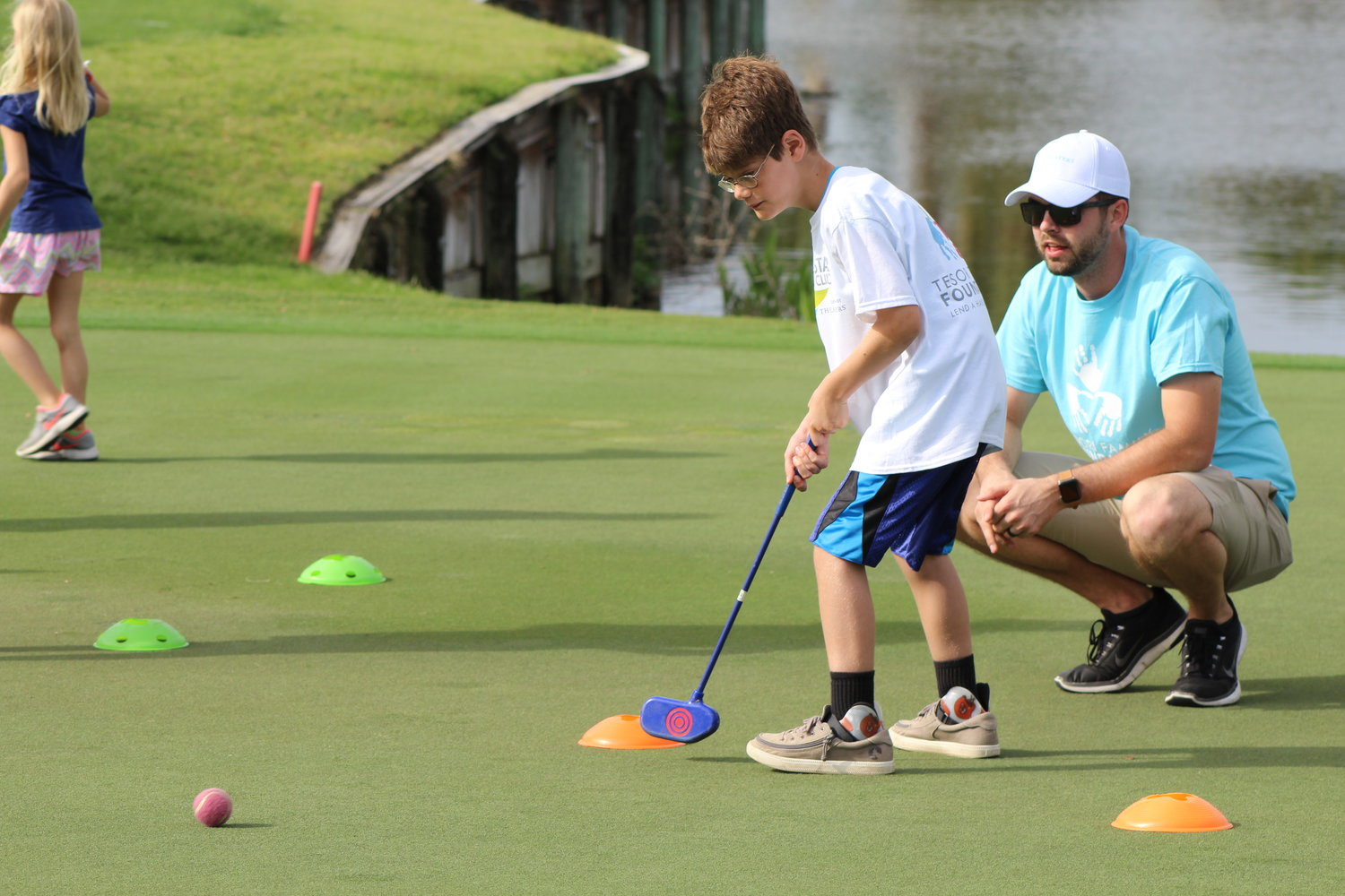 "A ""VIP"" attempts a putt at the All-Star Kids Clinic."