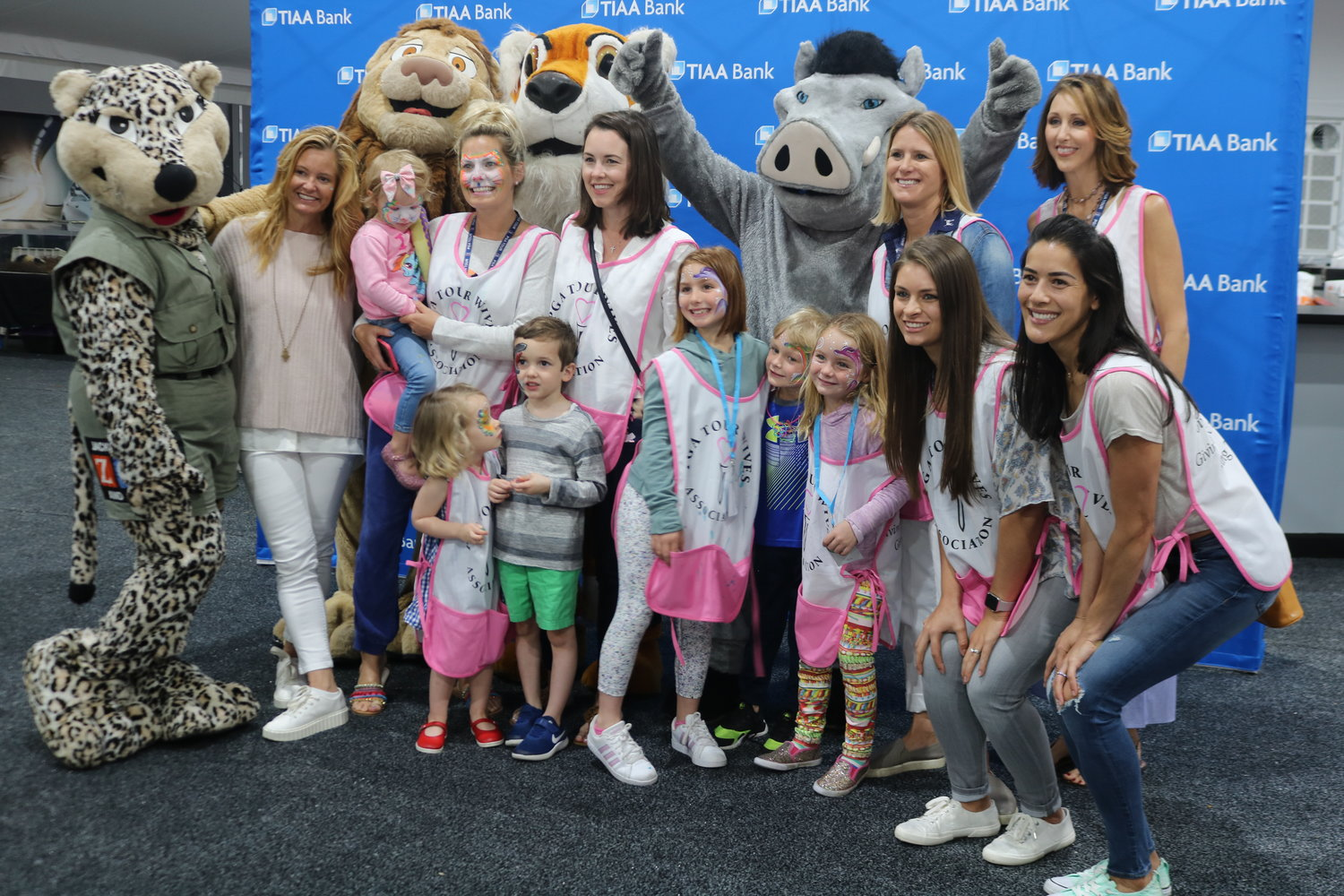 Chairperson Tabitha Furyk (left) and other PGA TOUR wives pose with Jacksonville Zoo characters.