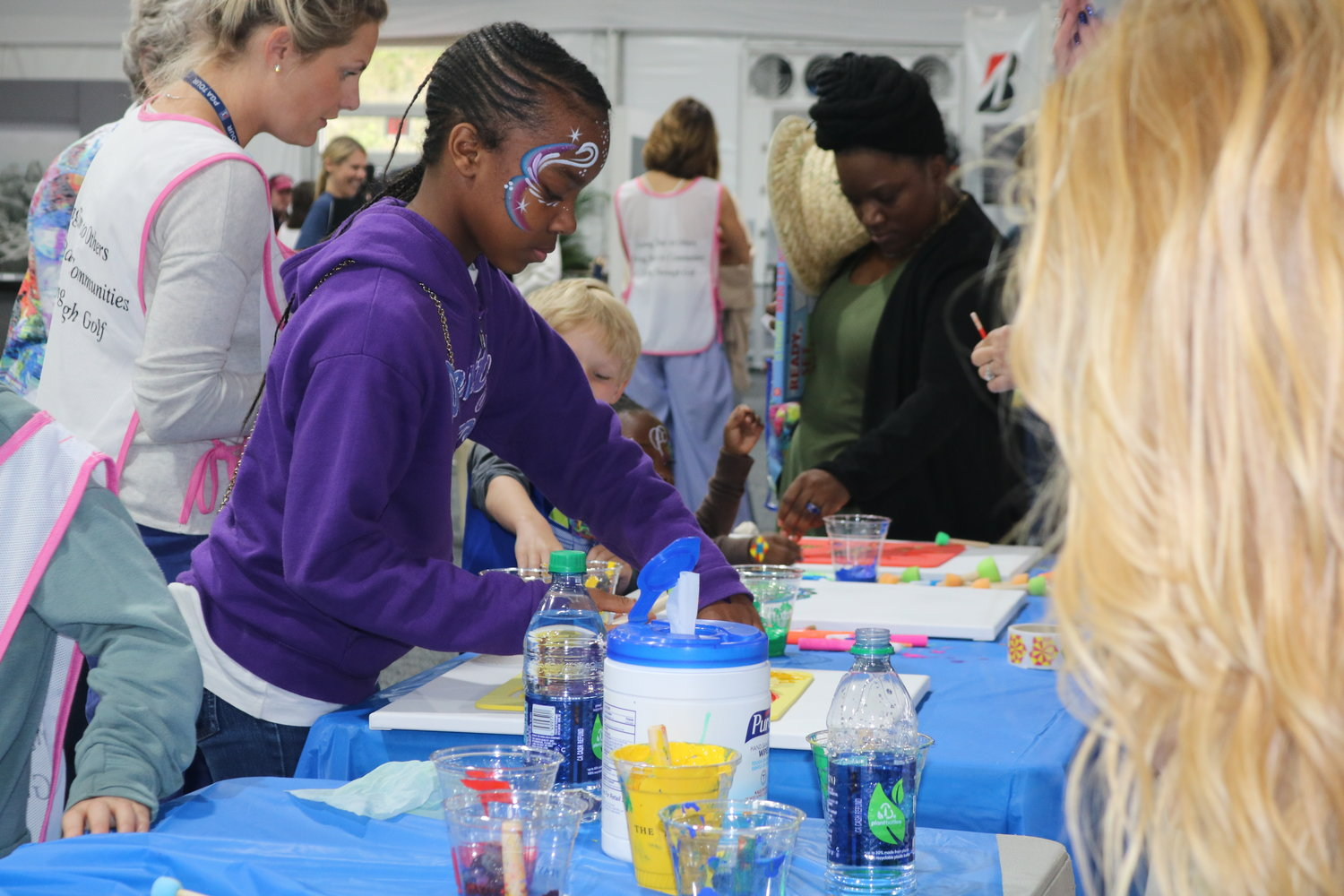 Kids at the event enjoys painting and arts and crafts.