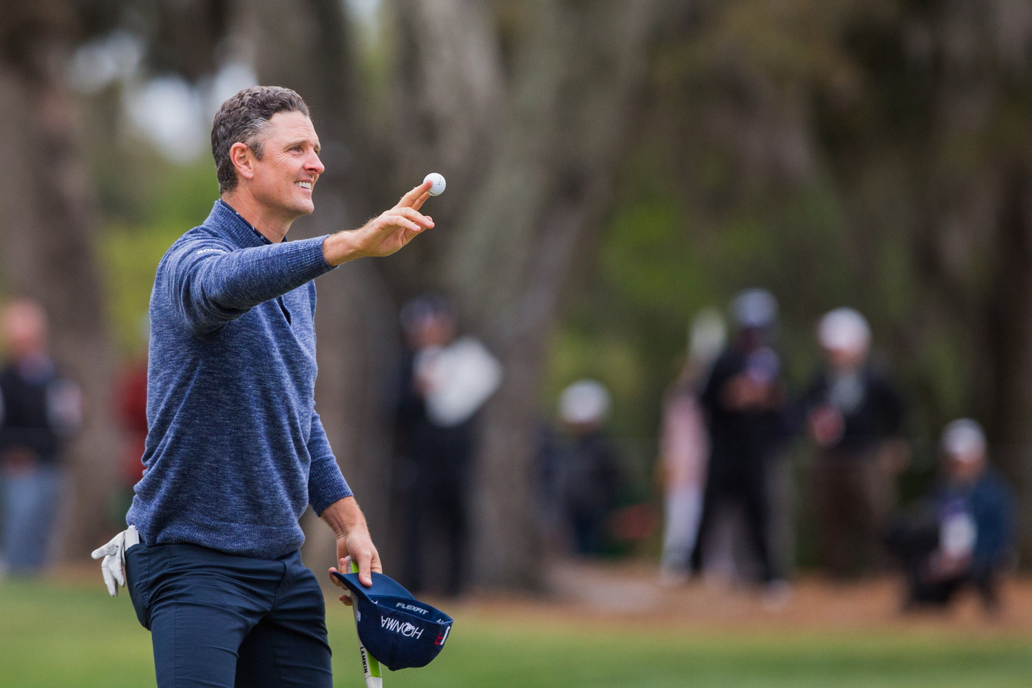 Justin Rose waves to fans Sunday at THE PLAYERS.