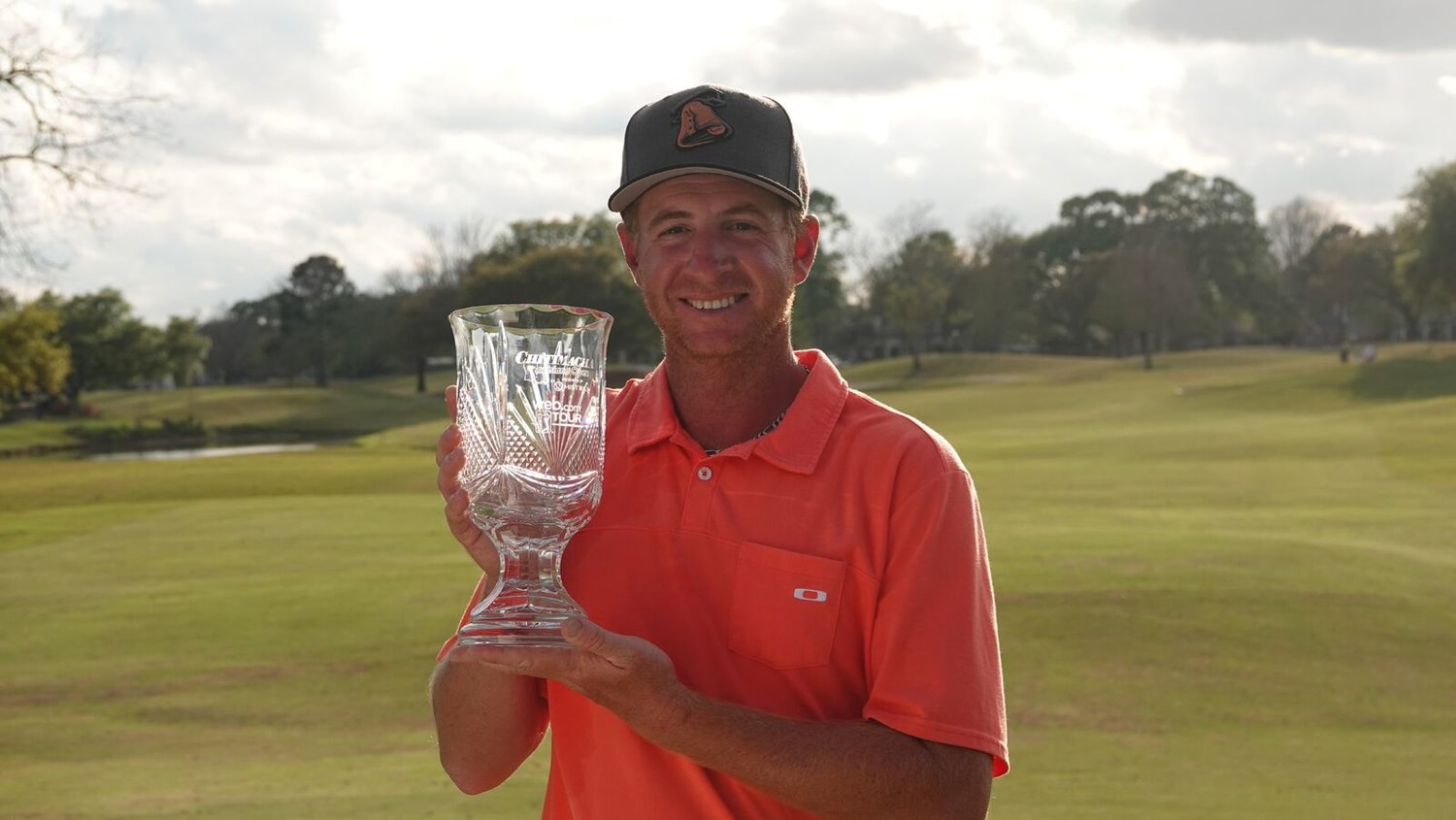 Nease graduate Vince Covello displays the trophy after winning the Chitimacha Louisiana Open on Sunday, his first Web.com Tour title.