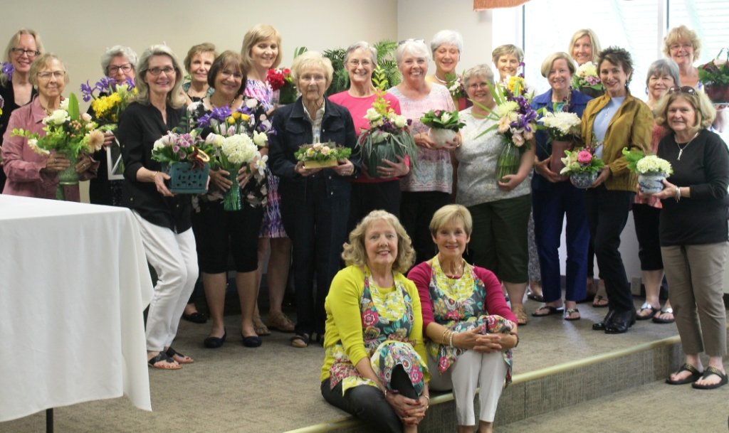 Flower arrangement winners gather at the Sisterhood of the Traveling Plants event.
