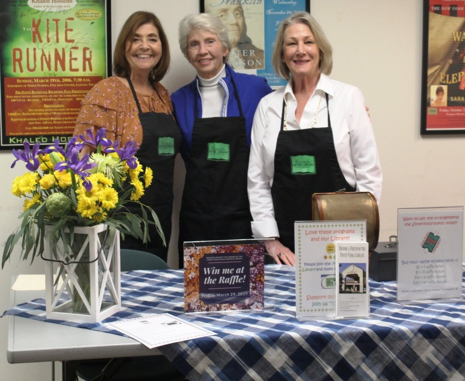 Friends of the Ponte Vedra Beach Branch Library Board Members Leslie Kleiman (president), Barbara Donnelly and Estes Carns sell raffle tickets and serve refreshments at the event.