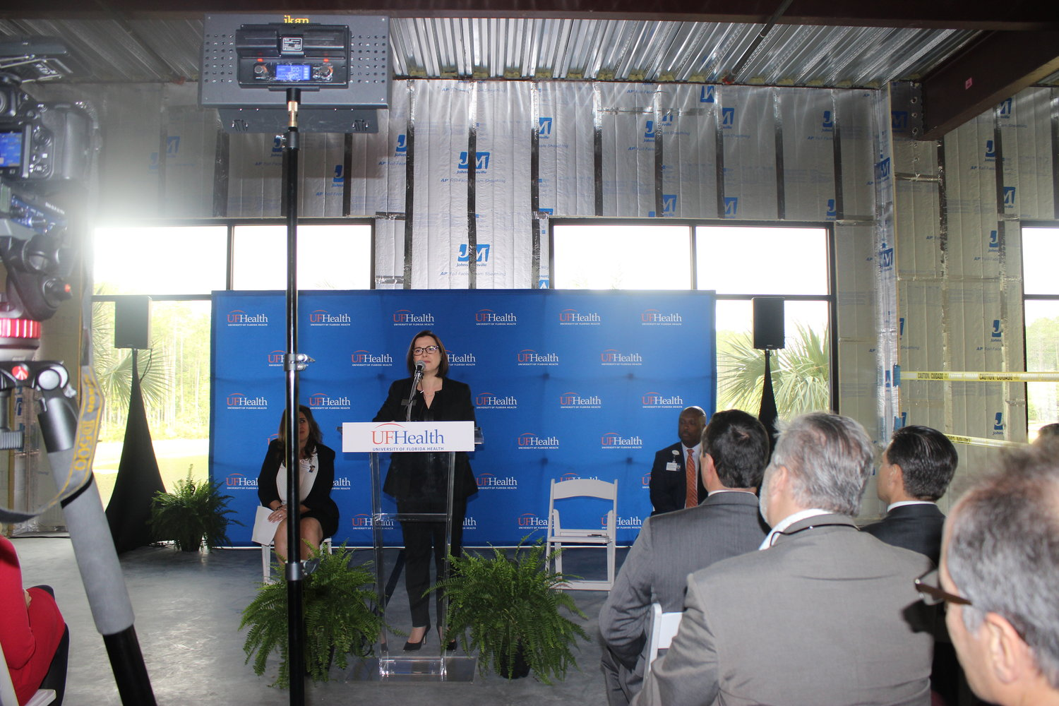 Isabelle Renault, president and CEO of the St. Johns County Chamber of Commerce, addresses attendees of the ribbon cutting.
