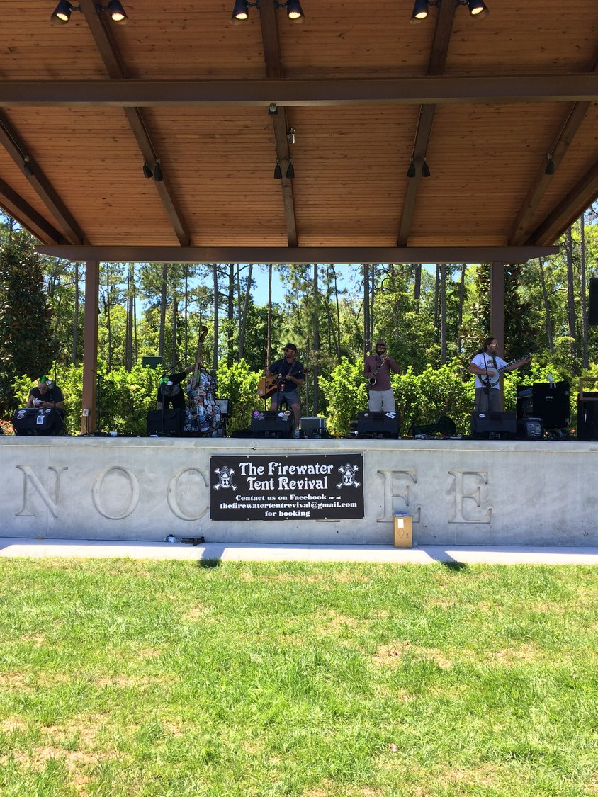 Firewater Tent Revival performs at the Farmers Market.