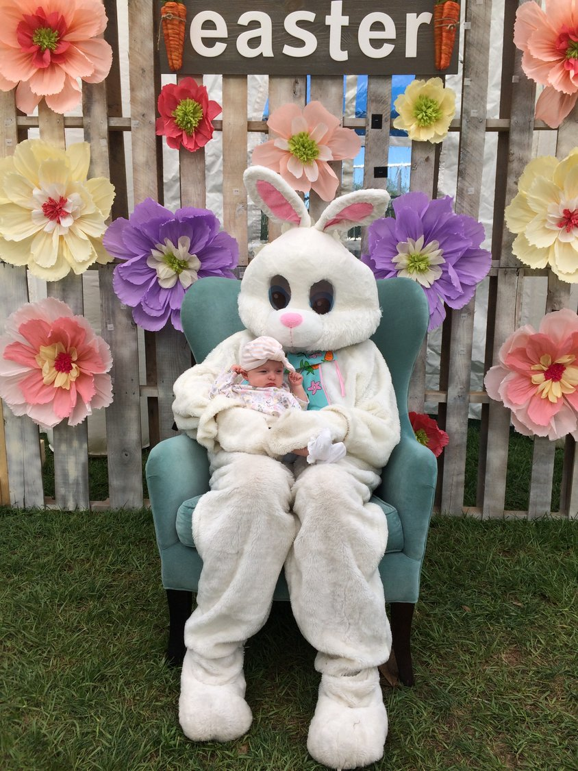 The Easter Bunny poses with a special friend at the Nocatee Farmers Market on Saturday.