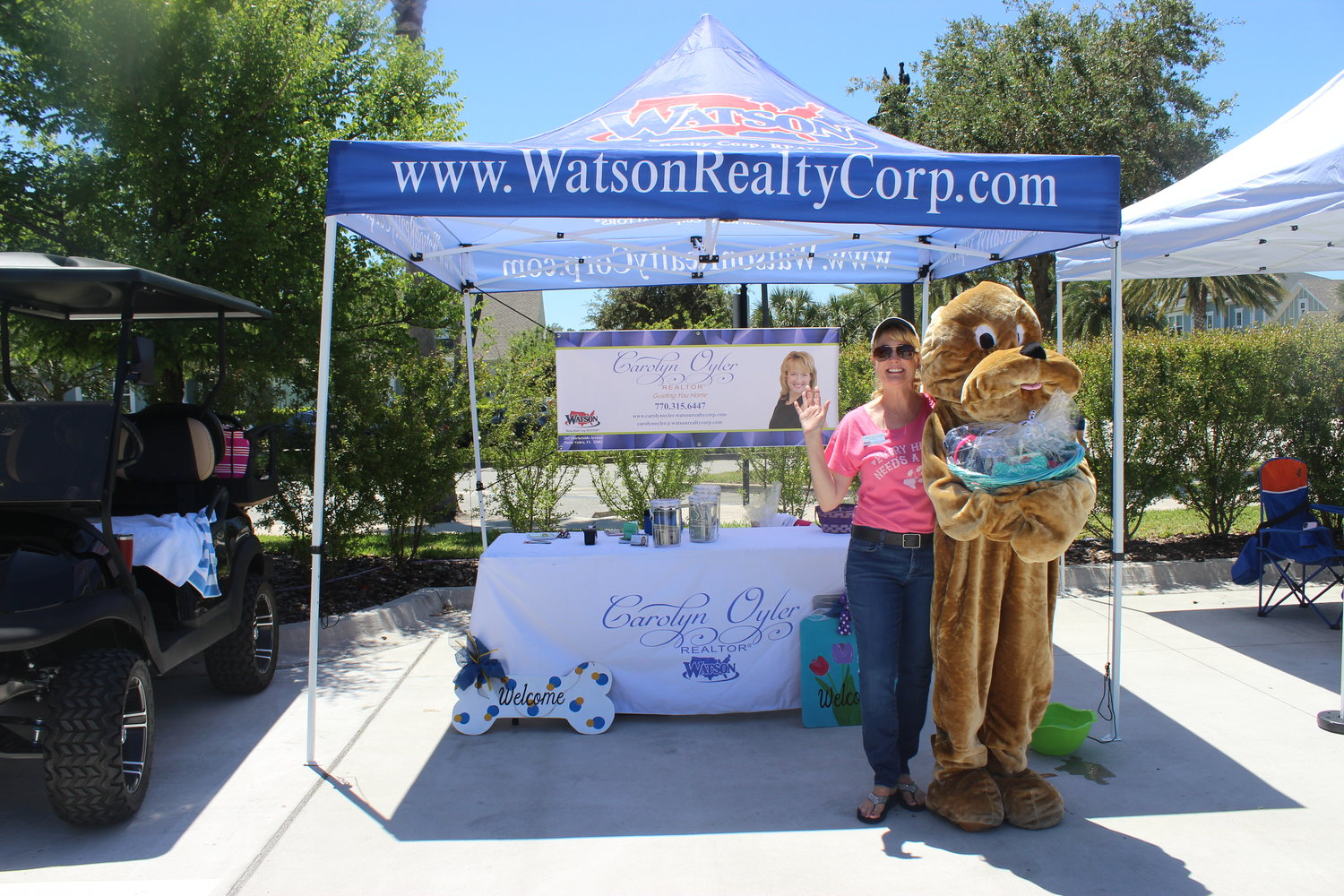 Watson Realty Corp. Realtor Carolyn Oyler enjoys her company's second annual Bubbles & Barks Doggie Wash Extravaganza on April 27 in Nocatee. Oyler was responsible for organizing much of the event.