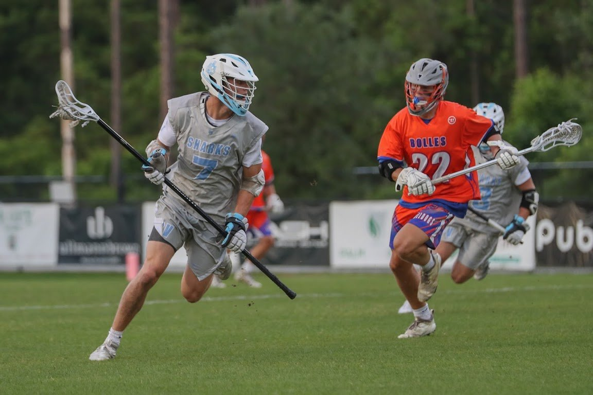 Junior long-stick midfielder Tommy Zitiello brings the ball downfield for Ponte Vedra in the Sharks' win over Bolles. Zitiello led the team with six groundballs.