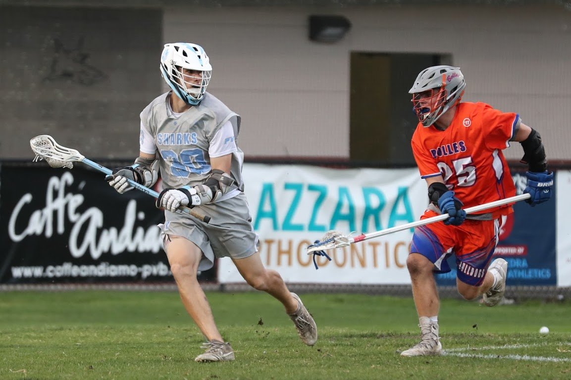 Senior attack Patrick Dotsikas cradles the ball for the Sharks against Bolles. He led Ponte Vedra in that game with four goals.