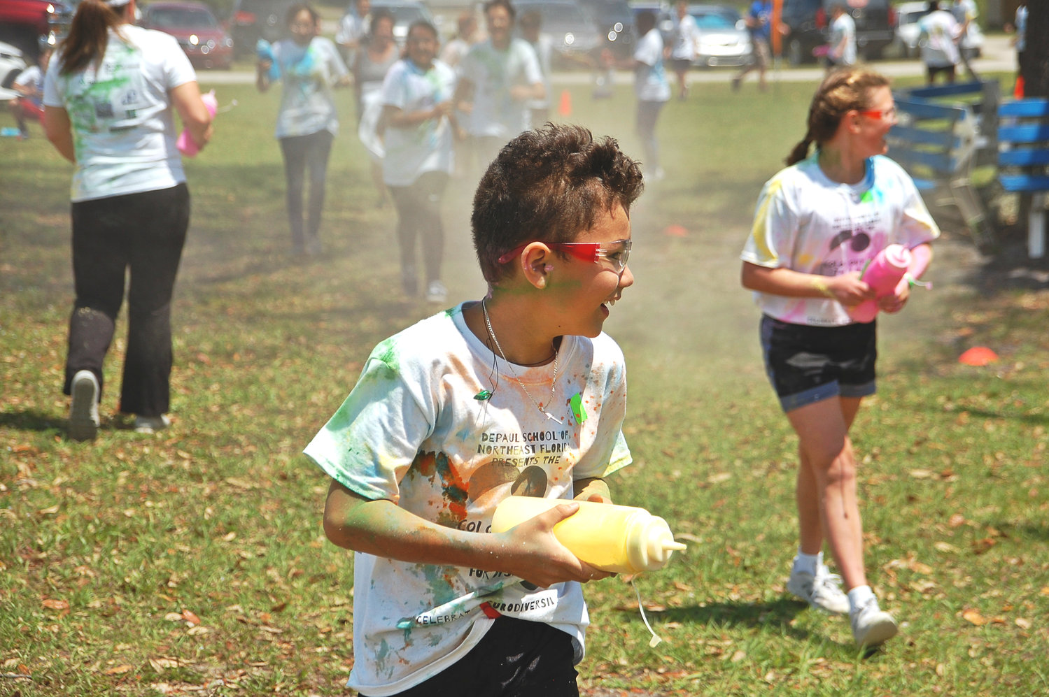 Elementary and middle schoolers in the Beaches area participate in a color run at DePaul School on April 26 to celebrate neurodiversity.