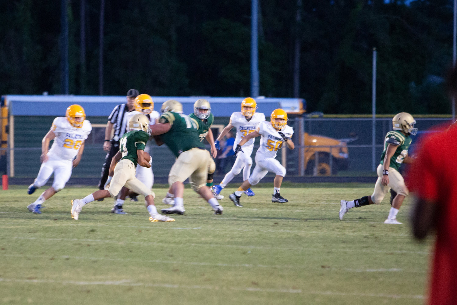 A Nease runner finds a hole against Palatka.
