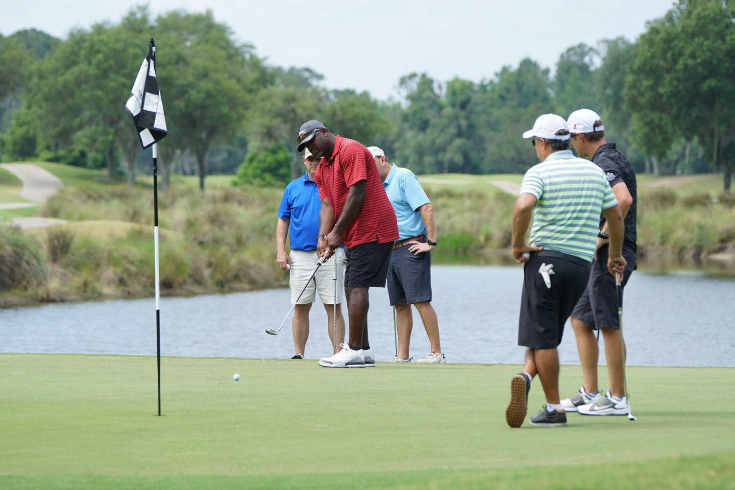 "Attendees of ""The Rahm"" enjoy playing golf at World Golf Village."