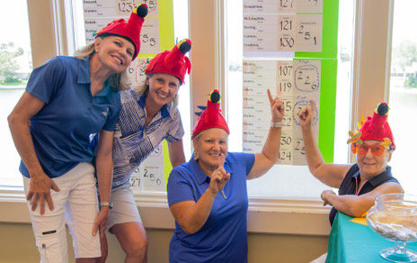 Winners of the PLGA Member-Guest Parrot Heads Flight Laurie Sikes (from left), Laurie Harris, Tammy Blades and Magi Jones.