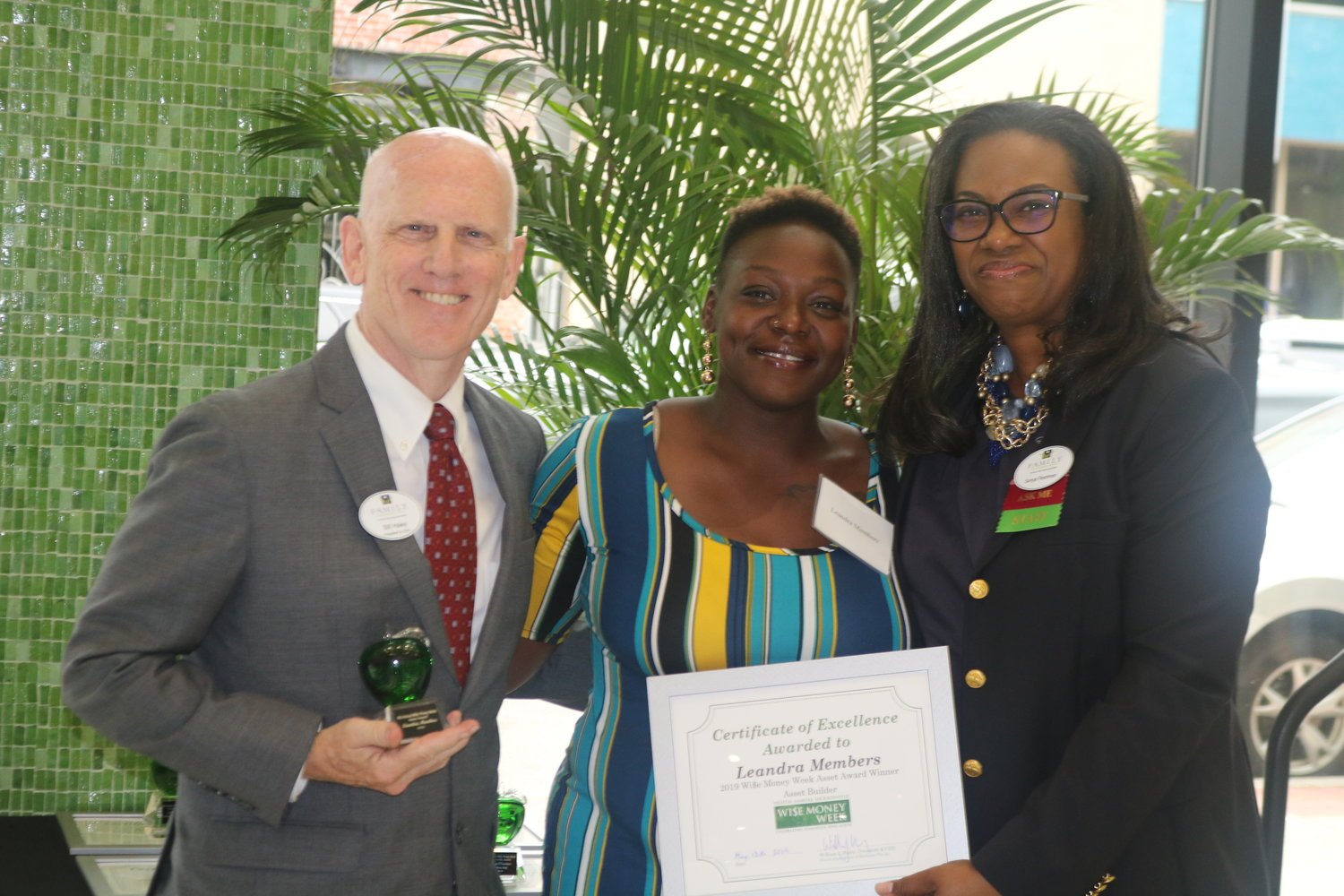 Family Foundations President and CEO Bill Haley and Manager of Financial Wellness Sonya Fleshman with LaTesha Jackson, winner of the 1st Time Homebuyer award.
