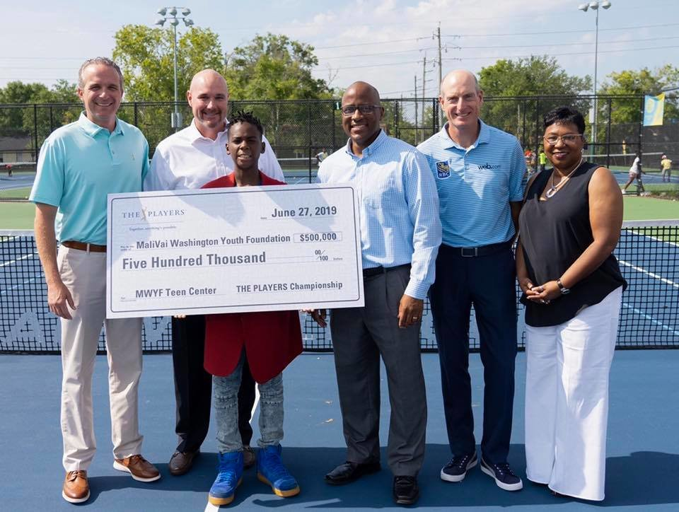PGA TOUR pro, Jim Furyk, second from right, joined MWYF Founder Mal Washington; THE PLAYERS' Executive Director, Jared Rice; and Duval County Public Schools' Superintendent, Diana Greene for the presentation.
