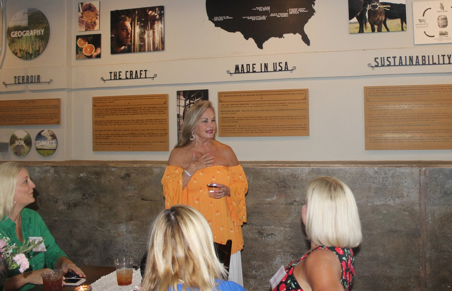 Women's Food Alliance founder, Leigh Cort, speaks to the members and guests of the WFA event at the St. Augustine Distillery.