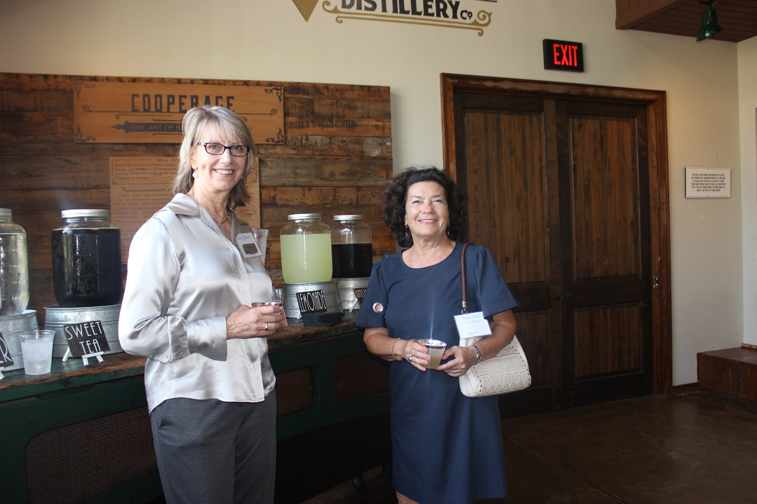 Members of the Women's Food Alliance, Carol Maurer and Benedetta Dubetz, enjoy some refreshments at the St. Augustine Distillery.
