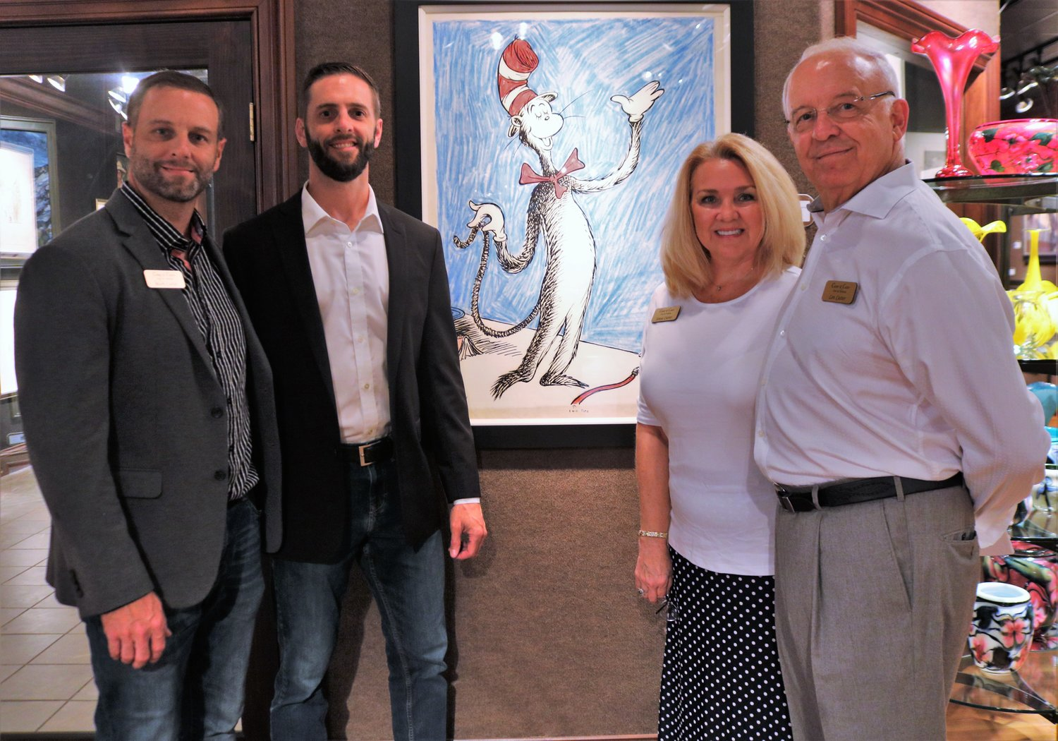 The Cutter family (Left to right), Mark, Matthew, Sonya and Len launched the opening of their gallery's Salvador Dali and Dr. Seuss exhibit on July 5 in the St. Augustine location.