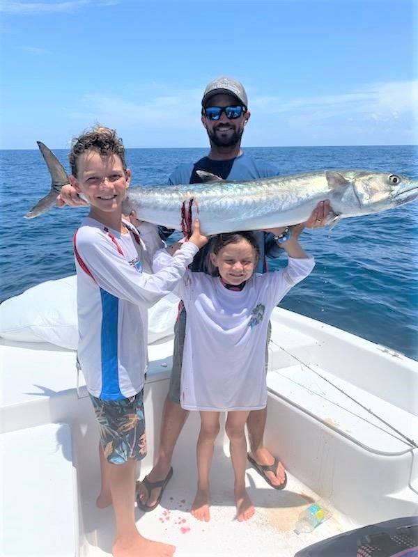 Brother and sister Keith and Savanna hold up the 29.55-pound king mackerel they caught during the Ancient City Game Fish Association's Junior Challenge with their dad, Keith Wilson on the Hakuna Matata. The juniors placed third in their division in the June 28 tournament.