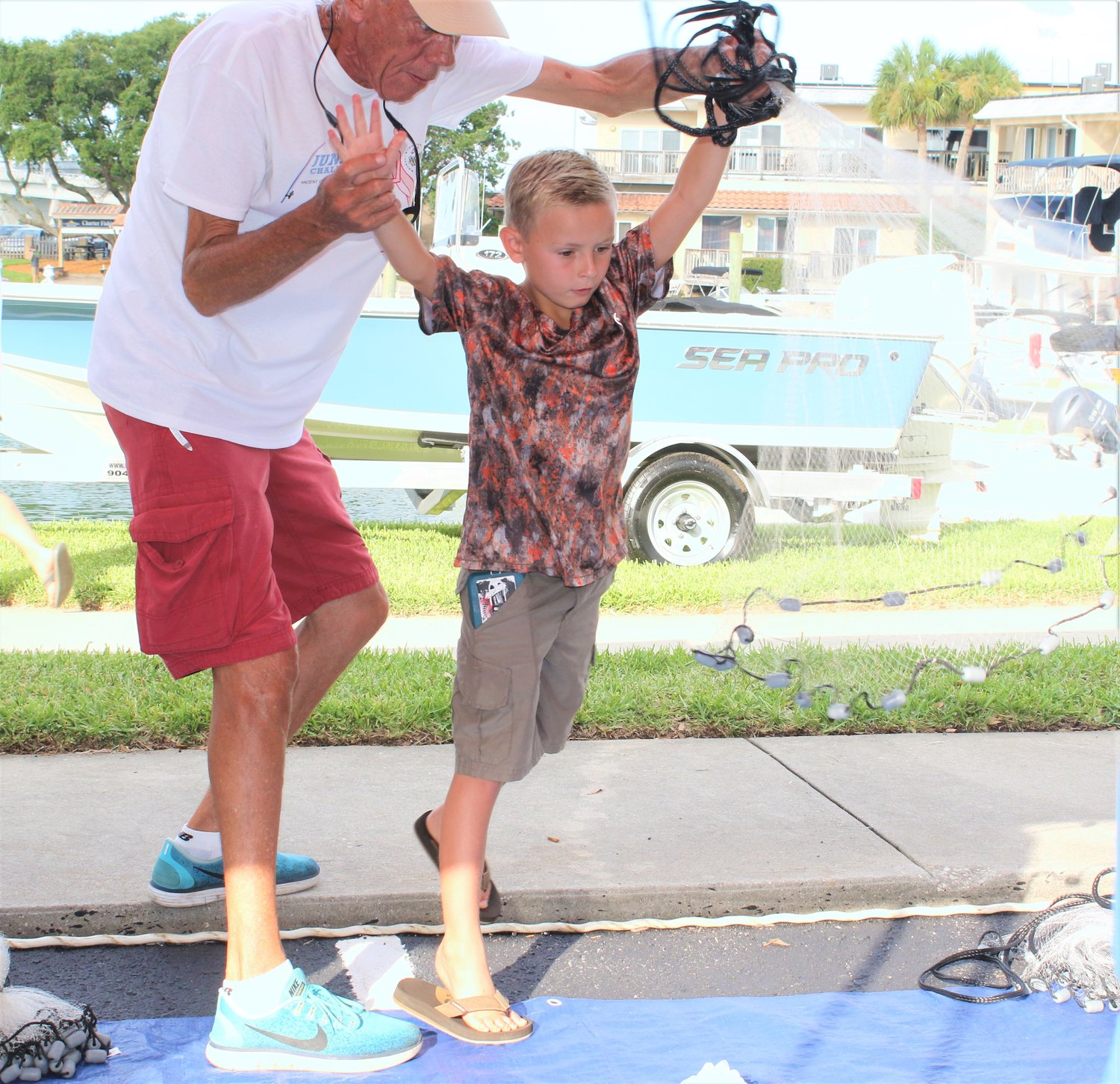 Nine-year-old Matthew Padgett learns to throw a cast at the ACGFA Kids' Clinic in June. Matthew has been a top contender in past Junior Backwater Challenge events but had never caught a kingfish. He put a 10.5-king on the board in the 2019 Junior Kingfish Challenge.