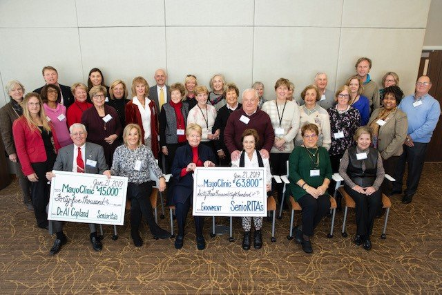 SenioRITAS presented checks to Mayo Clinic totaling more than $100,000 Jan. 21. The Women's Doubles Tennis Tournament benefits breast cancer research at Mayo Clinic.