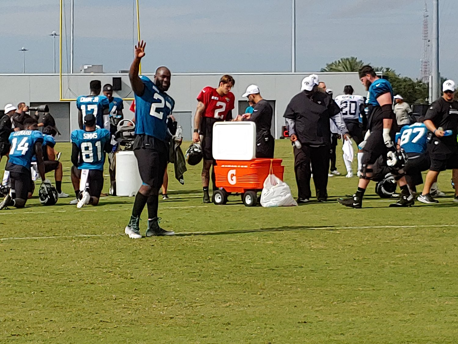 Jacksonville Jaguars RB, Leanard Fournette, waves to the crowd during practice.
