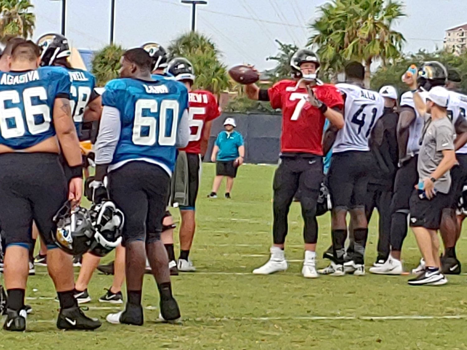 Starting QB for the Jags, Nick Foles, warmup his throwing arm before drills.