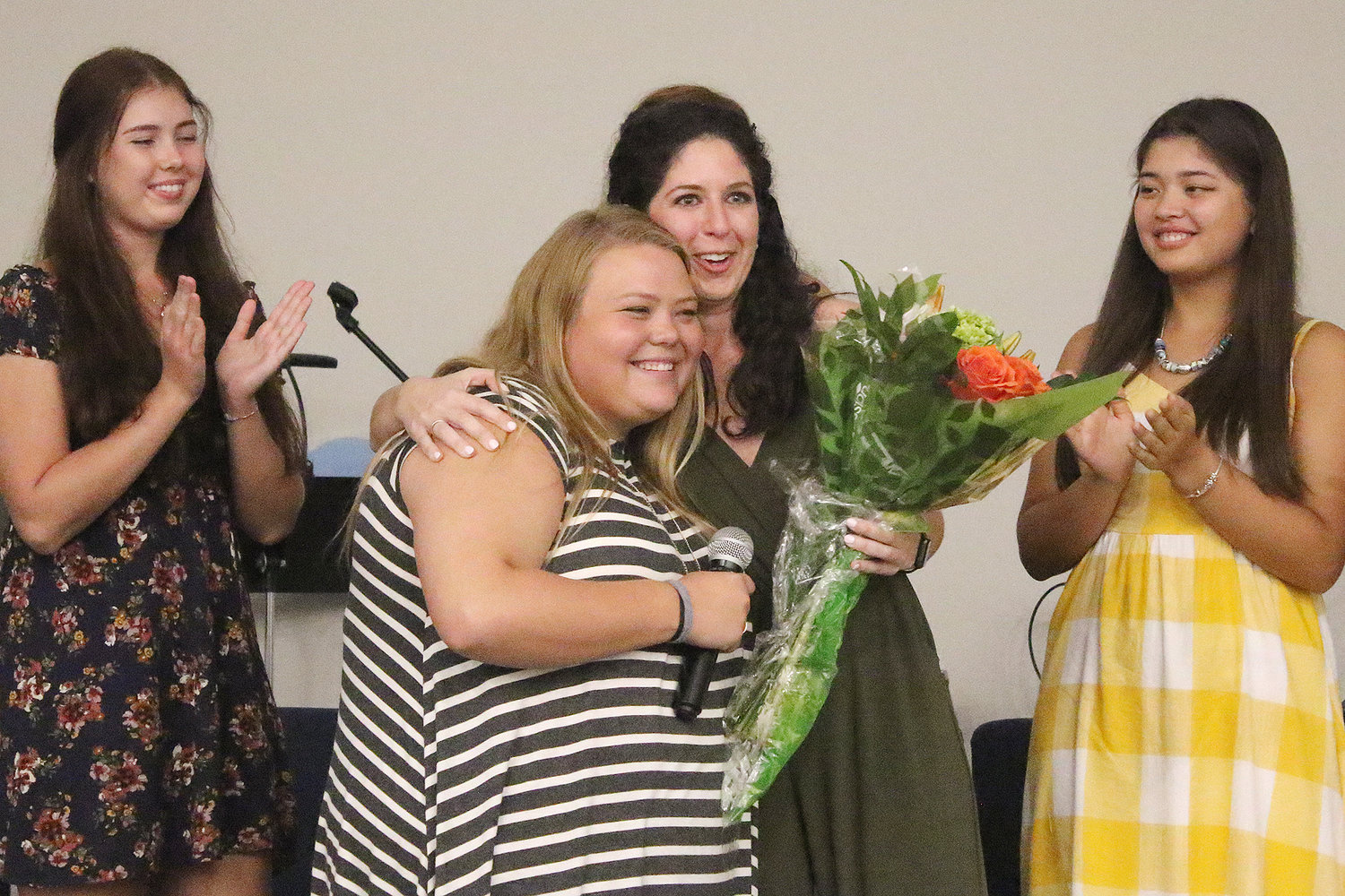 Katie Mahnken received flowers for her dedication to the girls. She is a Program Coordinator with The Greatest Exchange and lives in Kazakhstan for six months each year to find young women to participate in the program.